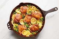 """For an easy, one-pan weeknight dinner, cumin and turmeric-rubbed chicken thighs go on top of a pile of silky cabbage to finish in the oven, then get topped with sweet peas and a flurry of fresh cilantro. <a href=""""https://www.epicurious.com/recipes/food/views/crispy-chicken-turmeric-lemon-cabbage-peas?mbid=synd_yahoo_rss"""" rel=""""nofollow noopener"""" target=""""_blank"""" data-ylk=""""slk:See recipe."""" class=""""link rapid-noclick-resp"""">See recipe.</a>"""