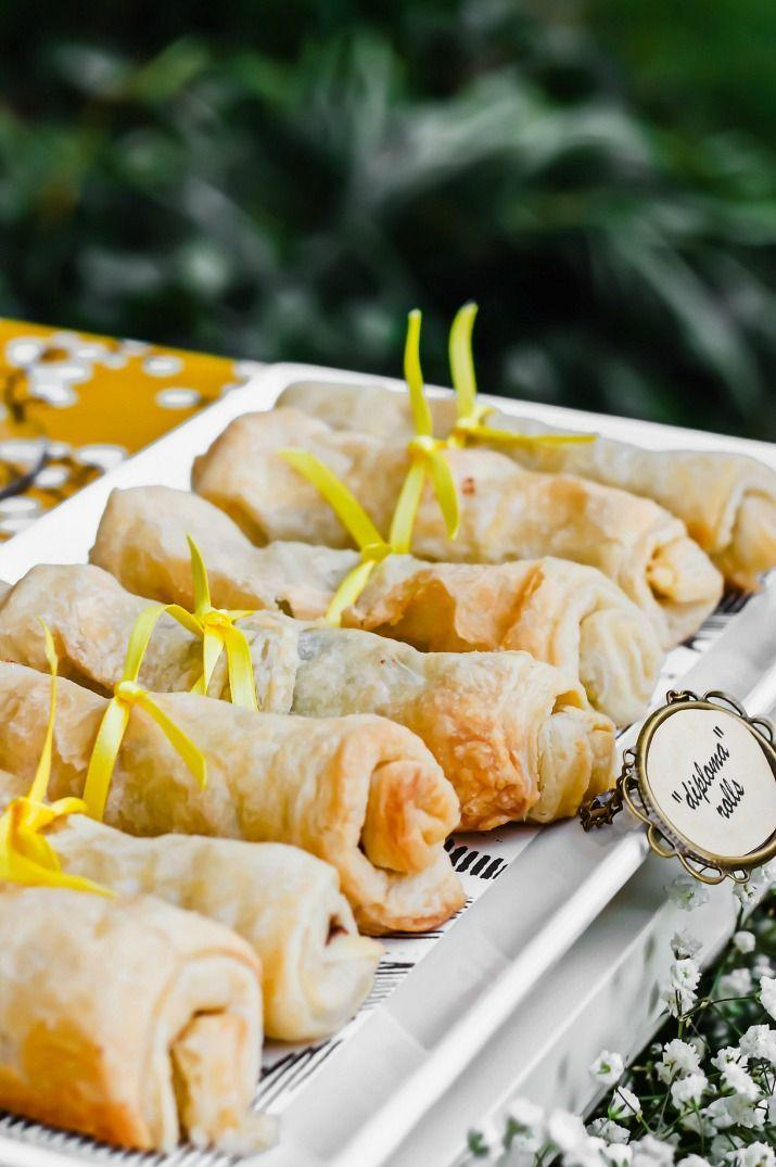 """<p>Not sure what to serve at your grad party? These on-theme Nutella diploma-shaped roll-ups are a great choice.</p><p><strong>See the tutorial at </strong><a href=""""https://celebrationsathomeblog.com/chocolate-filled-pastry-rolls-recipe/"""" rel=""""nofollow noopener"""" target=""""_blank"""" data-ylk=""""slk:Celebrations at Home"""" class=""""link rapid-noclick-resp""""><strong>Celebrations at Home</strong></a><strong>.</strong></p><p><a class=""""link rapid-noclick-resp"""" href=""""https://www.amazon.com/Product-Nutella-Hazelnut-Spread-Twin/dp/B07QBN14TS/ref=sr_1_2?keywords=nutella&qid=1578620635&sr=8-2&tag=syn-yahoo-20&ascsubtag=%5Bartid%7C10050.g.31121022%5Bsrc%7Cyahoo-us"""" rel=""""nofollow noopener"""" target=""""_blank"""" data-ylk=""""slk:SHOP NUTELLA""""><strong>SHOP NUTELLA</strong></a></p>"""
