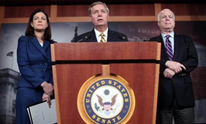 Sens. Lindsey Graham (S.C.), center, Kelly Ayotte (N.H.), and John McCain (Ariz.) continue to demand more information about Benghazi in order to vote on Hagel.