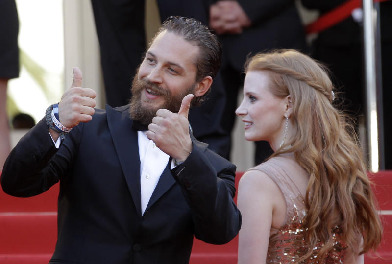 Actors Tom Hardy, left and Jessica Chastain arrive for the screening of Lawless at the 65th international film festival, in Cannes, southern France, Saturday, May 19, 2012. (AP Photo/Lionel Cironneau)