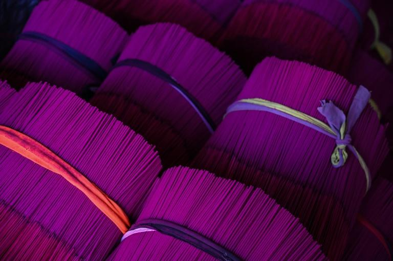 Finished incense sticks are bundled up at a factory in Fujian province, which supplies much of the world's incense