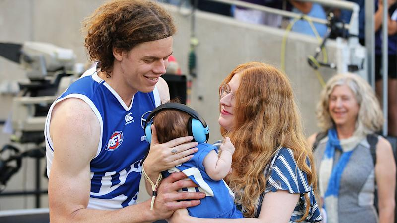 Seen here, Ben Brown, his wife Hester and their daughter Aila after a Kangaroos match.