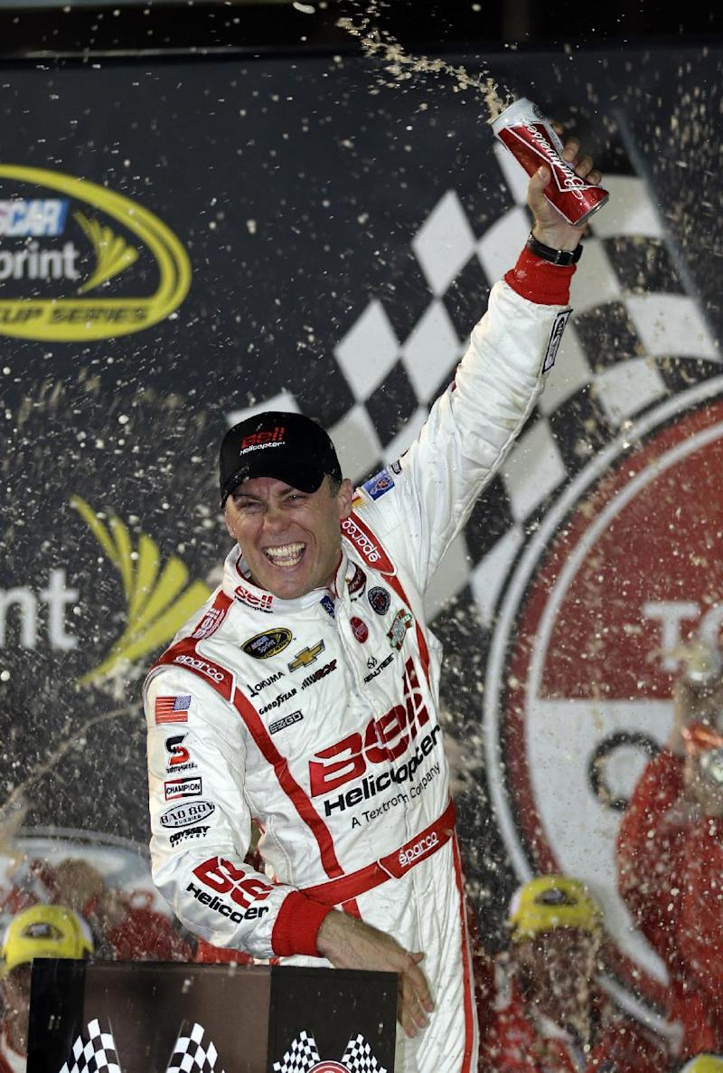 Kevin Harvick celebrates winning the Toyota Owner's 400 NASCAR Sprint Cup series auto race at Richmond International Raceway in Richmond, Va., Saturday April 27, 2013.  (AP Photo/Steve Helber)