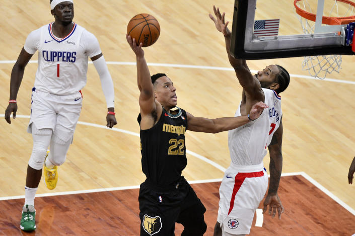 Memphis Grizzlies guard Desmond Bane (22) shoots against Los Angeles Clippers forward Kawhi Leonard (2) during the first half of an NBA basketball game Friday, Feb. 26, 2021, in Memphis, Tenn. (AP Photo/Brandon Dill)