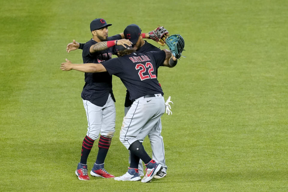Cleveland Indians outfielders celebrate after their baseball game against the Kansas City Royals Wednesday, May 5, 2021, in Kansas City, Mo. The Indians won 5-4. (AP Photo/Charlie Riedel)