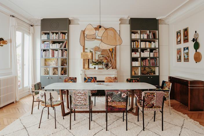 The custom-designed bookshelves by GCG are painted in Vert Antique by Argile. The large Concorde table is by Poliform and the chairs are by Fragonard.
