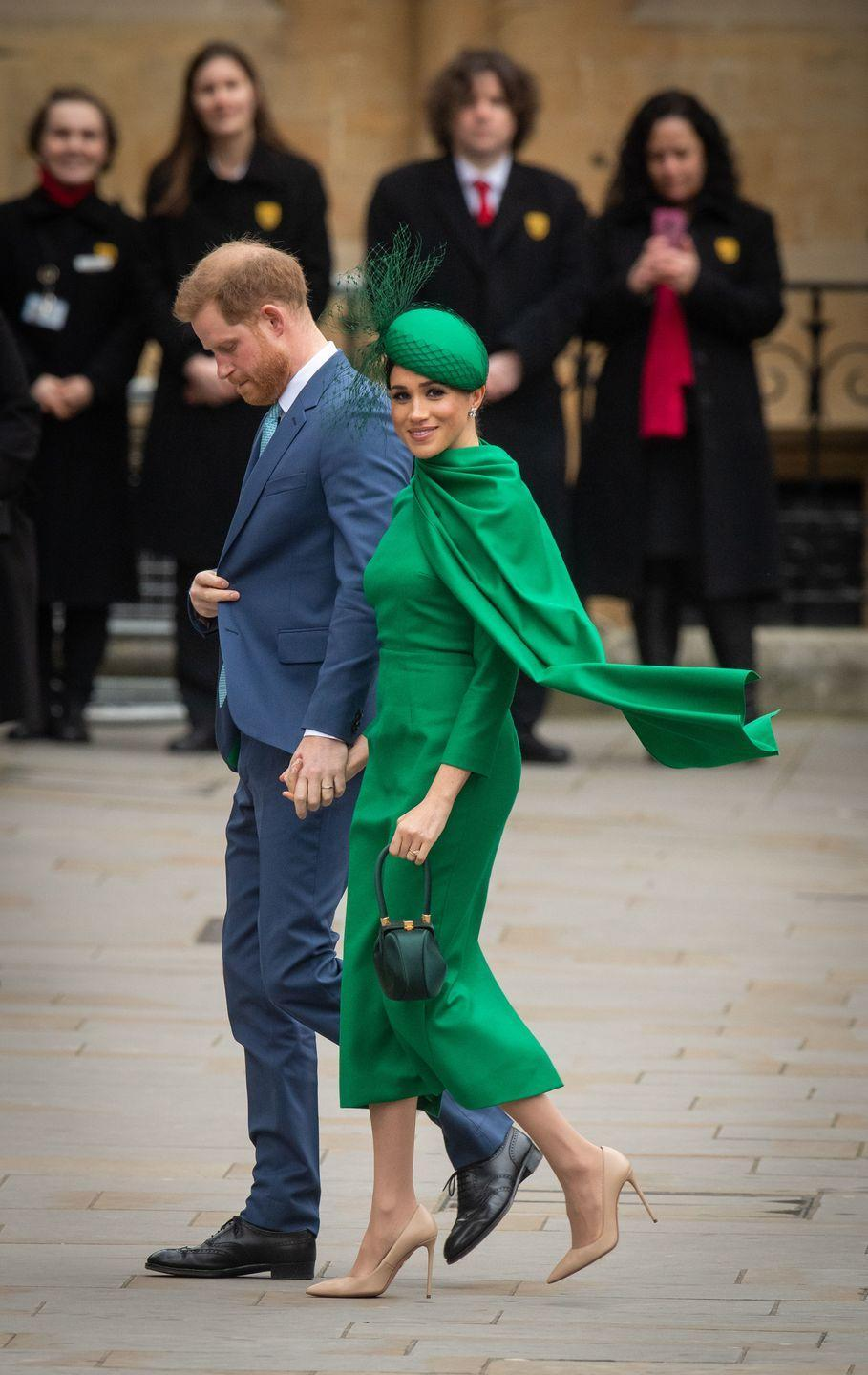 """<p>The Duchess arrived at Westminster Abbey for the annual Commonwealth Day Service <a href=""""https://www.townandcountrymag.com/society/tradition/a31279858/meghan-markle-green-emilia-wickstead-dress-commonwealth-day-service-photos-2020/"""" rel=""""nofollow noopener"""" target=""""_blank"""" data-ylk=""""slk:wearing a stunning Emilia Wickstead dress"""" class=""""link rapid-noclick-resp"""">wearing a stunning Emilia Wickstead dress</a>, paired with a William Chambers hat, Aquazzura heels, and a Gabriella Hearst bag.</p>"""