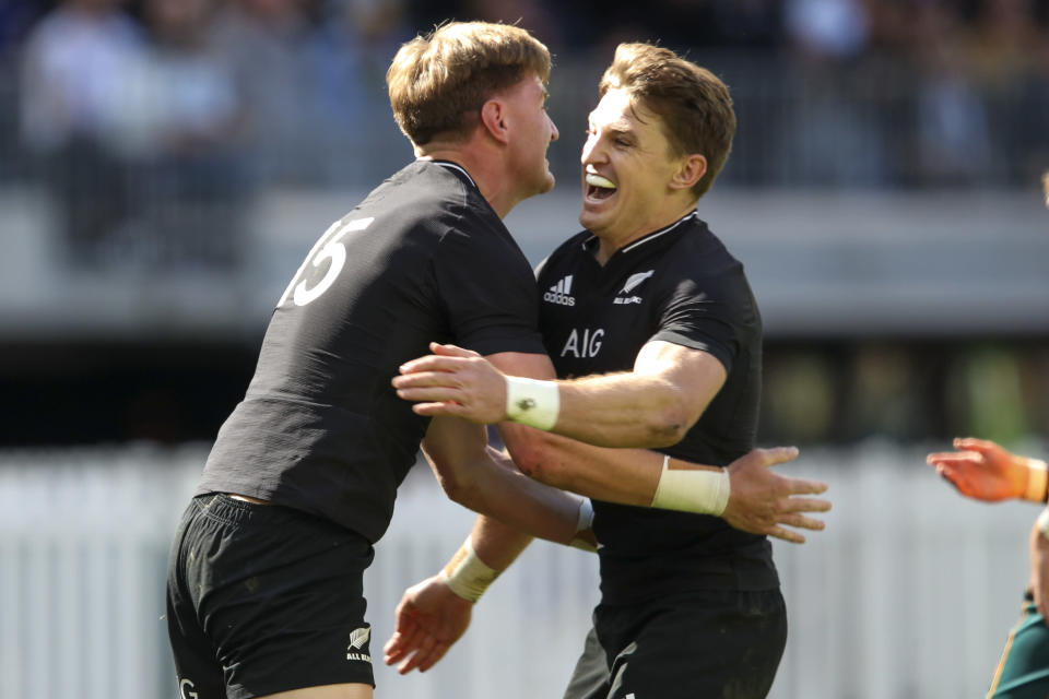 New Zealand's Jordie Barrett, left, is congratulated by teammate Beauden Barrett after scoring a try during the Rugby Championship game between the All Blacks and the Wallabies in Perth, Australia, Sunday, Sept. 5, 2021. (AP Photo/Gary Day)