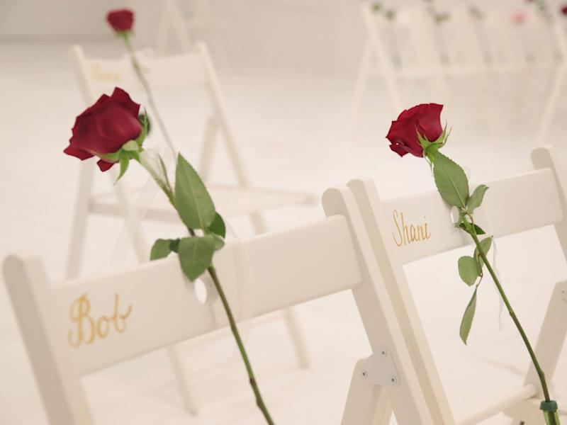 On each chair is a single rose and the name of a shooting victim: Getty Images