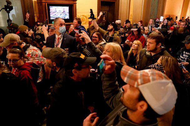 PHOTO: Protesters try to enter the Michigan House of Representative chamber after the American Patriot Rally for the reopening of businesses on the steps of the Michigan State Capitol in Lansing, Mich., April 30, 2020. (Jeff Kowalsky/AFP via Getty Images)