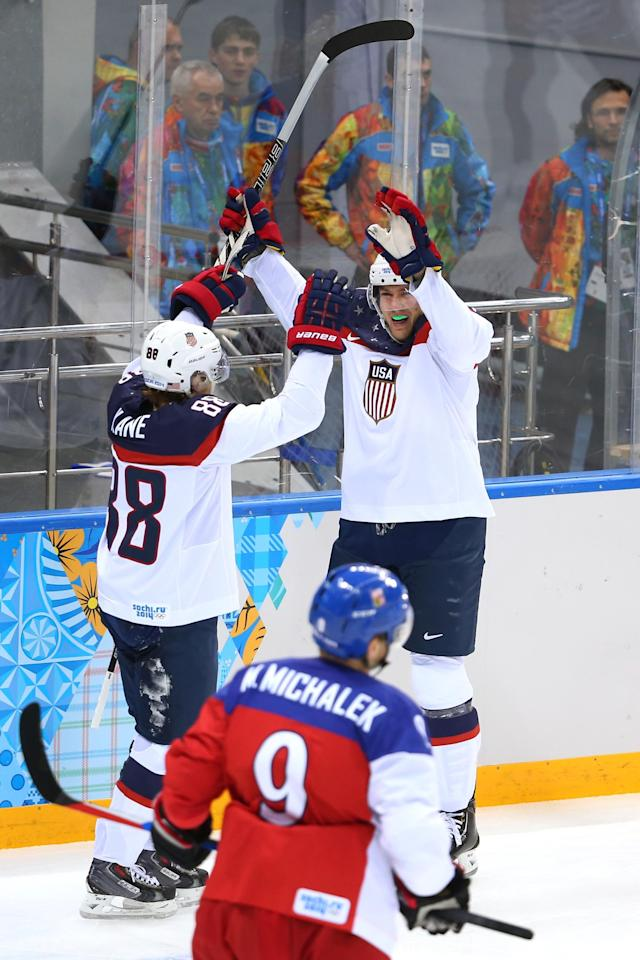 SOCHI, RUSSIA - FEBRUARY 19: James van Riemsdyk #21 of the United States celebrates with his teammate Patrick Kane #88 of the United States after scoring a goal in the first period against Ondrej Pavelec #31 of the Czech Republic during the Men's Ice Hockey Quarterfinal Playoff on Day 12 of the 2014 Sochi Winter Olympics at Shayba Arena on February 19, 2014 in Sochi, Russia. (Photo by Quinn Rooney/Getty Images)