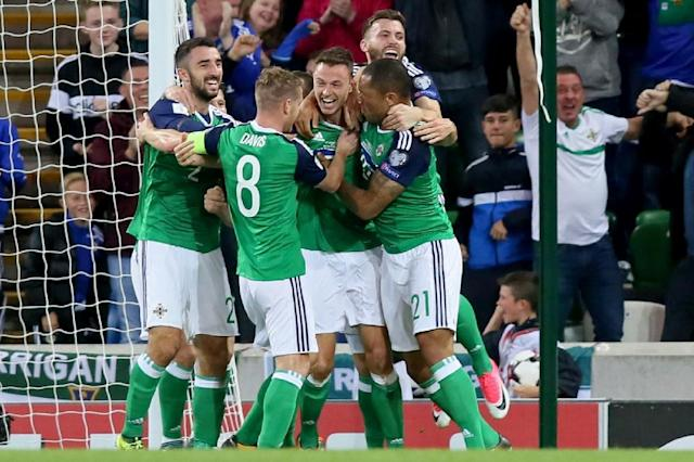 Northern Ireland's defender Jonny Evans (C) celebrates scoring during a World Cup qualification football match against the Czech Republic at Windsor Park in Belfast, Northern Ireland on September 4, 2017 (AFP Photo/Paul FAITH)