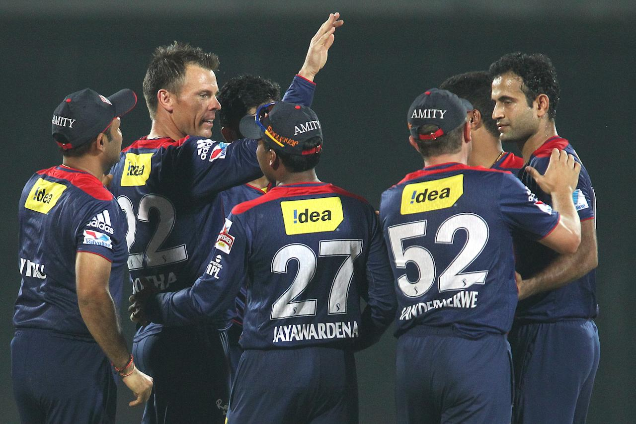 Johan Botha of Delhi Daredevils and Irfan Pathan of Delhi Daredevils are congratulated for getting Kings XI Punjab captain Adam Gilchrist wicket during match 32 of the Pepsi Indian Premier League between The Delhi Daredevils and the Kings XI Punjab held at the Feroz Shah Kotla Stadium, Delhi on the 23rd April 2013..Photo by Shaun Roy-IPL-SPORTZPICS  ..Use of this image is subject to the terms and conditions as outlined by the BCCI. These terms can be found by following this link:..https://ec.yimg.com/ec?url=http%3a%2f%2fwww.sportzpics.co.za%2fimage%2fI0000SoRagM2cIEc&t=1502943012&sig=GhHUDqaZrMzovkSxInc_yA--~D