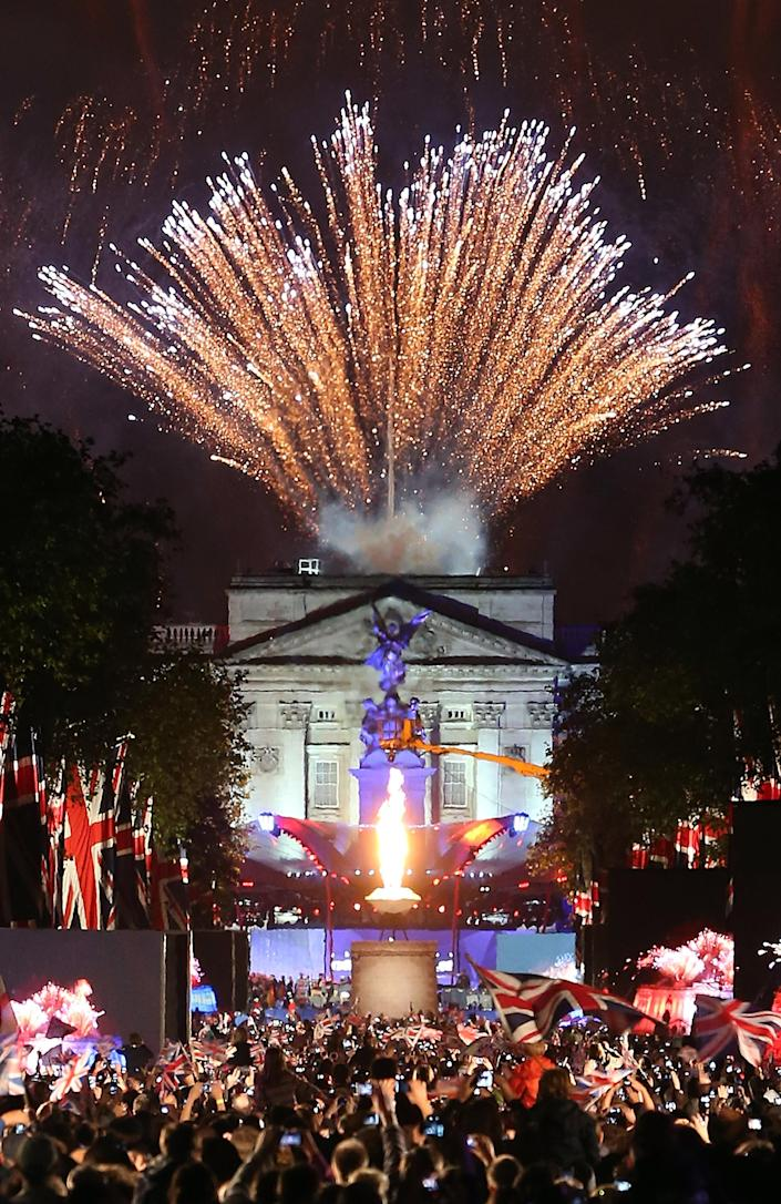 Fireworks over Buckingham Palace mark the end of The Diamond Jubilee Concert from The Mall on June 4, 2012 in London, England. For only the second time in its history the UK celebrates the Diamond Jubilee of a monarch. Her Majesty Queen Elizabeth II celebrates the 60th anniversary of her ascension to the throne. Thousands of well-wishers from around the world have flocked to London to witness the spectacle of the weekend's celebrations. (Photo by Peter Macdiarmid/Getty Images)