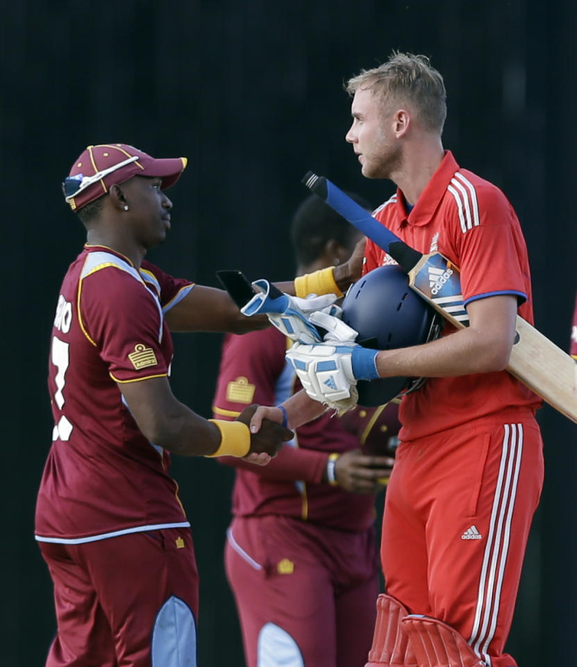 England's captain Stuart Broad, right, greets West Indies' captain Dwayne Bravo after the teams' second one-day international cricket match at Sir Vivian Richards Cricket Ground in St. John's, Antigua, Sunday, March 2, 2014. England won by three wickets. (AP Photo/Ricardo Mazalan)