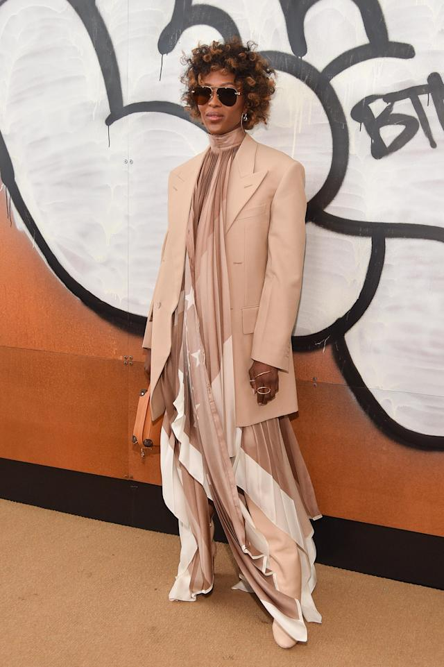 Between the laidback curls and beige boho style, this look appears to be taken straight out of the wardrobe of Queen of boho, Zoë Kravitz, and we <em>love </em>this style on Campbell. [Getty Images]