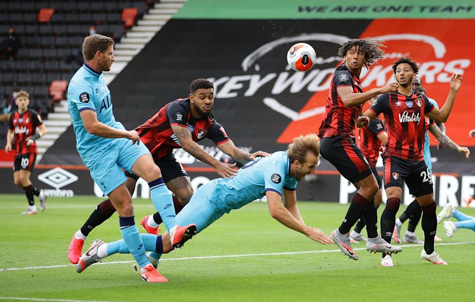 The Premier League said Tottenham Hotspur's Harry Kane (center) should have been given a penalty kick after being pushed by Bournemouth's Joshua King. (RICHARD HEATHCOTE/POOL/AFP via Getty Images)