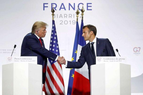 PHOTO: President Donald Trump shakes hands with French President Emmanuel Macron during a joint press conference at the end of the G7 summit in Biarritz, France, Aug. 26, 2019. (Christian Hartmann/Reuters)