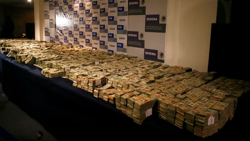 FILE PHOTO: Seized bundles of cash are displayed for the media in Mexico City