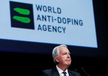 FILE PHOTO: Craig Reedie, President of the World Anti Doping Agency (WADA) addresses the WADA Symposium in Ecublens, Switzerland, March 13, 2017. REUTERS/Denis Balibouse