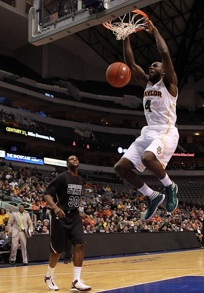 DALLAS, TX - DECEMBER 28:  Quincy Acy #4 of the Baylor Bears makes the slam dunk against Wendell Lewis #30 of the Mississippi State Bulldogs at American Airlines Center on December 28, 2011 in Dallas, Texas.  (Photo by Ronald Martinez/Getty Images)