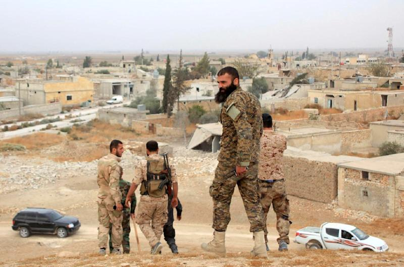 Syrian government forces pictured in the village of Jabboul, on the eastern outskirts of Aleppo, after taking control of the village from the Islamic State (IS) group militants on October 24, 2015 (AFP Photo/George Ourfalian)