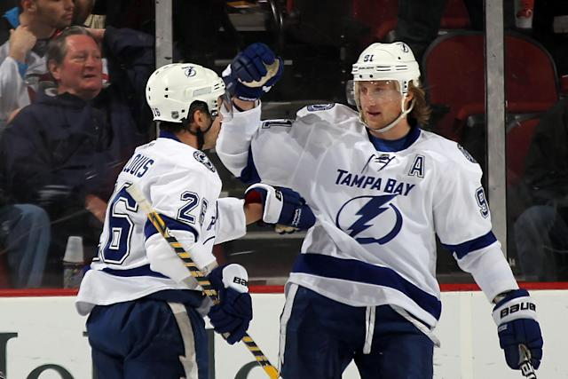 NEWARK, NJ - FEBRUARY 26: Martin St. Louis #26 (L)of the Tampa Bay Lightning scores at 6:39 of the second period against the New Jersey Devils and is joined by Steven Stamkos #91 (R) at the Prudential Center on February 26, 2012 in Newark, New Jersey. (Photo by Bruce Bennett/Getty Images)