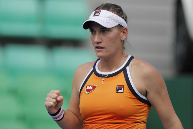 Timea Babos of Hungary reacts after scoring a point against Jelena Ostapenko of Latvia during their first round match of the Korea Open tennis championships in Seoul, South Korea, Tuesday, Sept. 17, 2019. (AP Photo/Lee Jin-man)