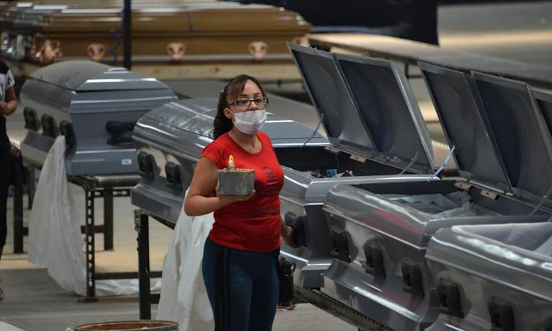 A worker wears a face mask in a factory in Mexico City making coffins designed to b hermetically sealed to transport corpses of people who died from Covid-19.