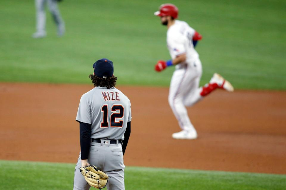 Detroit Tigers starting pitcher Casey Mize (12) watches Texas Rangers right fielder Joey Gallo (right) round the bases after hitting a home run in the second inning at Globe Life Field. Wednesday, July 7, 2021.
