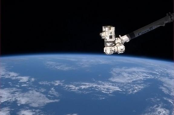 """The robotic arm of the space station give the Earth a """"thumbs up"""" according to Chris Hadfield. Taken on"""