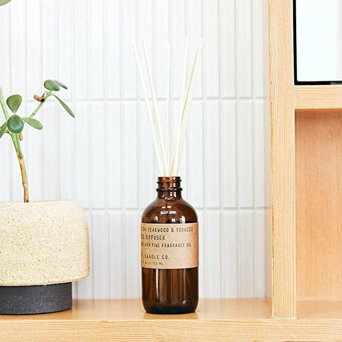 """<p>""""I first got a whiff of this <span> P.F. Candle Co. Teakwood &amp; Tobacco Classic Scented Rattan Reed Diffuser</span> ($25) while on set for work. Hiding inside a little studio bathroom was this tobacco- and teakwood-scented scent that, for a year now, I haven't forgotten about. Now that cozy season is upon us, I know this warm and shockingly sexy scent will be a signature in my itty-bitty apartment."""" - SS</p>"""