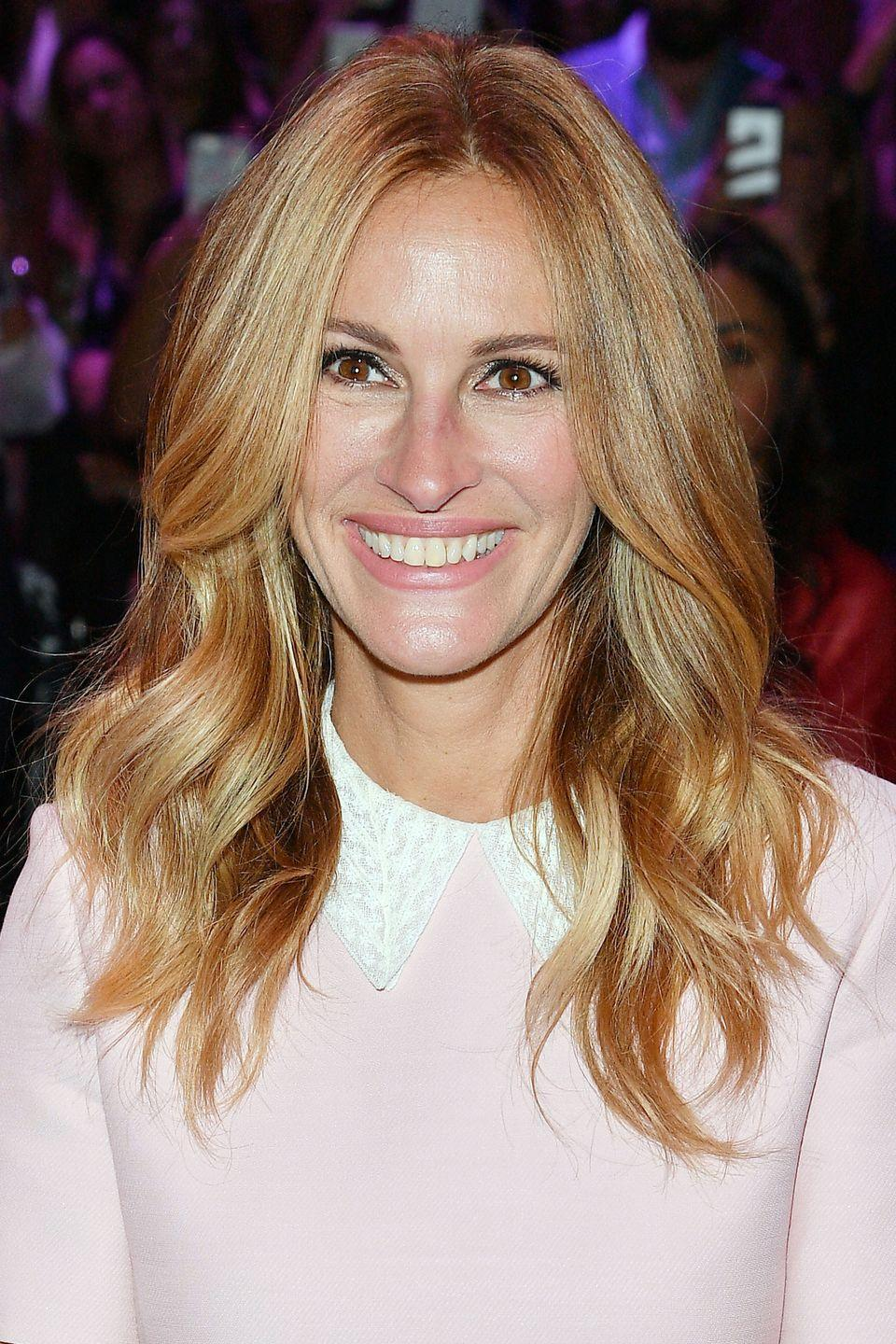 """<p>Although Julia Roberts has done a lot of experimenting with her hair over the years, she has stuck to a flattering golden-blonde <a href=""""http://www.goodhousekeeping.com/beauty/hair/g3279/balayage-hair-color/"""" rel=""""nofollow noopener"""" target=""""_blank"""" data-ylk=""""slk:balayage"""" class=""""link rapid-noclick-resp"""">balayage</a> with loose waves more recently. </p>"""