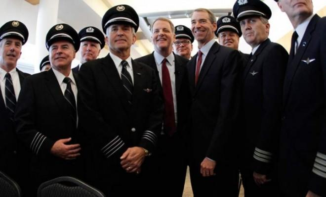 CEOs Doug Parker and Thomas Horton of US Airways and American Airlines stand with pilots from both airlines during the companies' merger announcement.