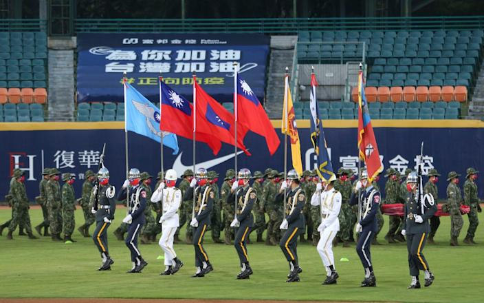 Honour guards perform before a baseball game in Taipei - Chiang Ying-ying/AP