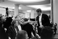 """<p>After arriving at his inaugural ball, JFK greets his supporters and gives a few remarks to the hoards of ticket holders who came to celebrate. This comes a mere hours after his<a href=""""https://www.jfklibrary.org/asset-viewer/archives/USG/USG-01-12/USG-01-12"""" rel=""""nofollow noopener"""" target=""""_blank"""" data-ylk=""""slk:historic inaugural address"""" class=""""link rapid-noclick-resp""""> historic inaugural address</a>, where he stated, """"Ask not what your country can do you for—ask what you can do for your country.""""</p>"""