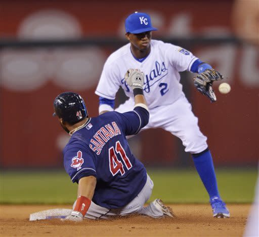 Cleveland Indians' Carlos Santana (41) is safe at second ahead of this throw to Kansas City Royals shortstop Alcides Escobar (2) for an RBI double during the fifth inning of a baseball game between the Kansas City Royals and Cleveland Indians, Monday, April 29, 2013, in Kansas City, Mo. (AP Photo/Reed Hoffmann)