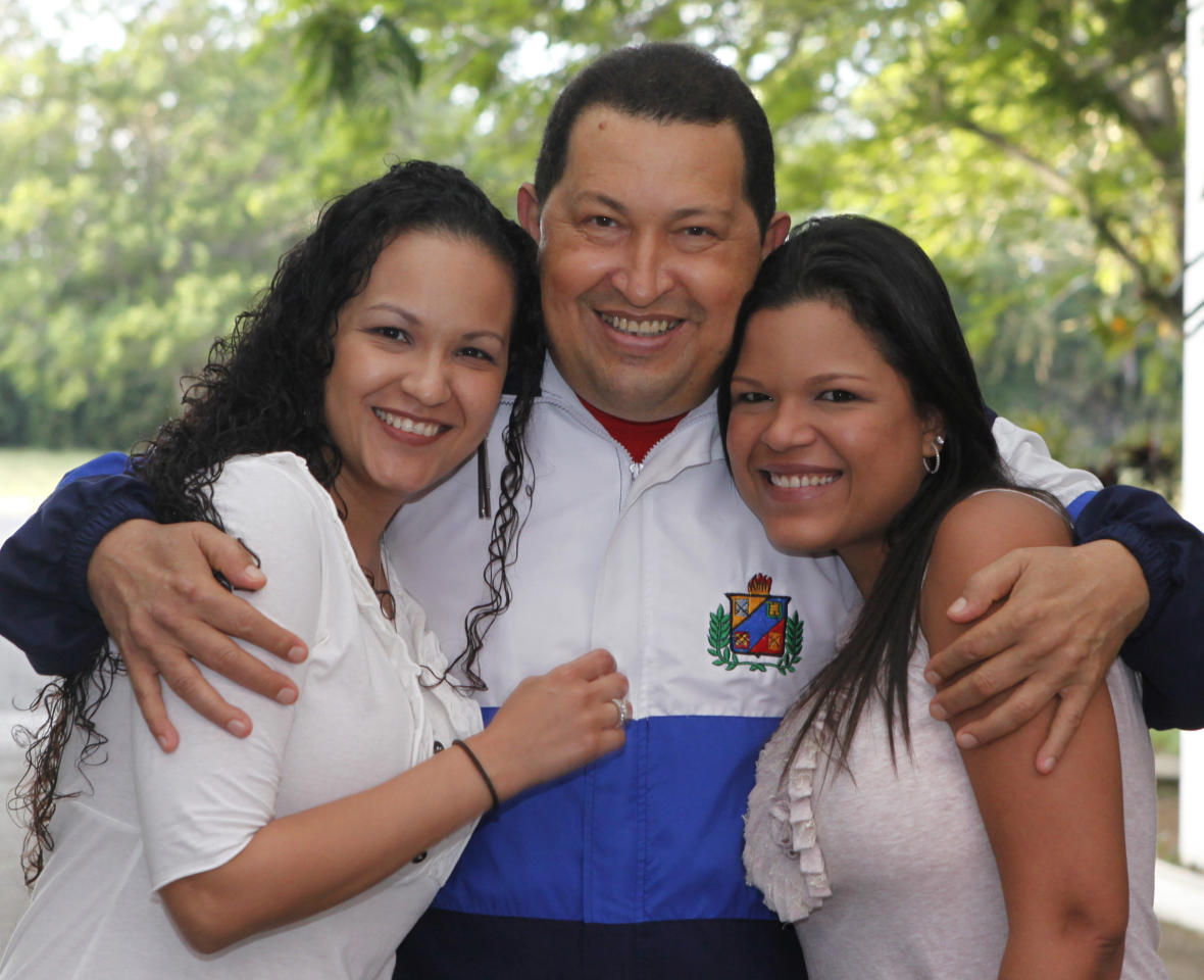In this photo released by Miraflores Press Office, Venezuela's President <font>Hugo</font> <font>Chavez</font> pose for a picture hugging his daughters <font>Rosa</font> <font>Virginia</font>,  left, and Maria Gabriela in a photo taken on Wednesday, March 7, 2012  in Havana, Cuba. The photo was taken before Wednesday meeting with his  Colombian counterpart Juan Manuel Santos in Havana, where he's  convalescing after undergoing cancer surgery last week. (AP  Photo/Miraflores Press Office/Marcelo Garcia)