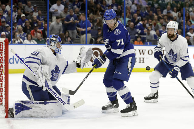 Tampa Bay Lightning center Anthony Cirelli (71) attempts to deflect a shot by Toronto Maple Leafs goaltender Frederik Andersen (31) during the second period of an NHL hockey game Tuesday, Feb. 25, 2020, in Tampa, Fla. (AP Photo/Chris O'Meara)
