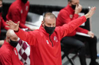 Utah head coach Larry Krystkowiak directs his team in the first half during an NCAA college basketball game against Oregon, Saturday, Jan. 9, 2021, in Salt Lake City. (AP Photo/Rick Bowmer)