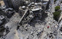 An aerial view of a destroyed building after it was hit last week by Israeli airstrikes, in Gaza City, Saturday, May 22, 2021.(AP Photo/Khalil Hamra)