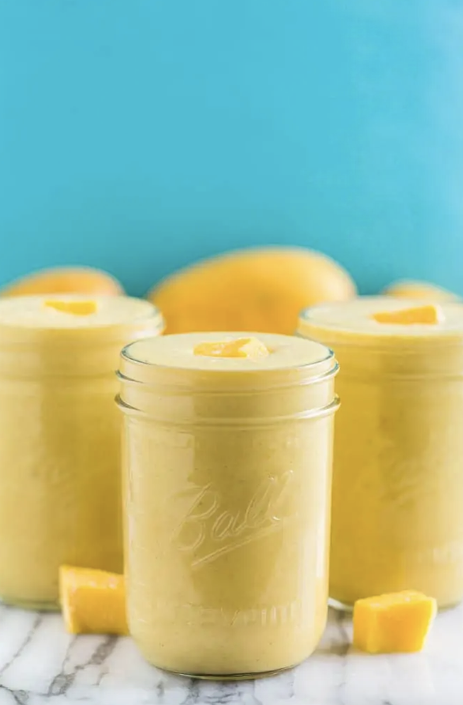 """<p>With ingredients like pineapple, mango chunks, banana, ginger, turmeric, and more, this smoothie will start your day off fruity and bright. Plus, it looks super pretty in the jar. </p><p><a class=""""link rapid-noclick-resp"""" href=""""https://getinspiredeveryday.com/food/golden-milk-tropical-turmeric-smoothie/"""" rel=""""nofollow noopener"""" target=""""_blank"""" data-ylk=""""slk:Get the recipe"""">Get the recipe</a></p>"""