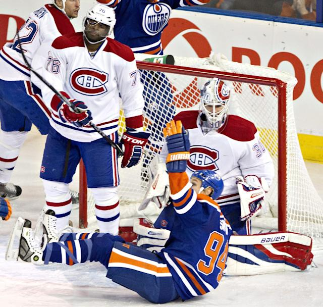 Montreal Canadians' P.K. Subban (76) and Peter Budaj (30) look on as Edmonton Oilers' Ryan Smyth (94) celebrates a goal during second-period NHL hockey game action in Edmonton, Alberta, Thursday, Oct. 10, 2013. (AP {Photo/The Canadian Press, Jason Franson)