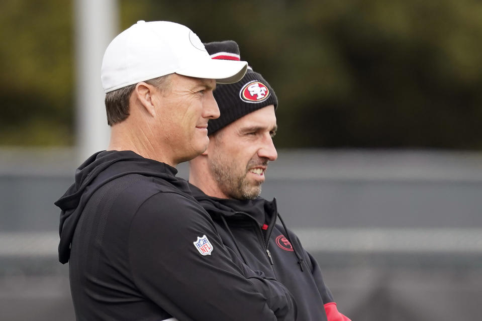 San Francisco 49ers head coach Kyle Shanahan, right, and general manager John Lynch have big QB decisions coming this offseason. (AP Photo/Tony Avelar)