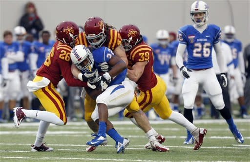 Iowa State defensive backs Deon Broomfield (26) and Marcus Pate (39), and linebacker A.J. Klein (47) tackle Tulsa running back Trey Watts (22) after a short gain in the first half of the Liberty Bowl NCAA college football game in Memphis, Tenn., Monday, Dec. 31, 2012. (AP Photo/Rogelio V. Solis)