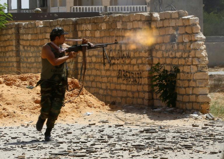 A fighter loyal to the internationally recognised Libyan Government of National Accord trades fire with forces loyal to strongman Khalifa Haftar in the capital Tripoli's suburb of Ain Zara. The photo was taken in September last year
