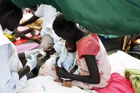 A medical staff attends to a malnourished child at a MSF hospital in an IDP camp inside the U.N. base in Malakal