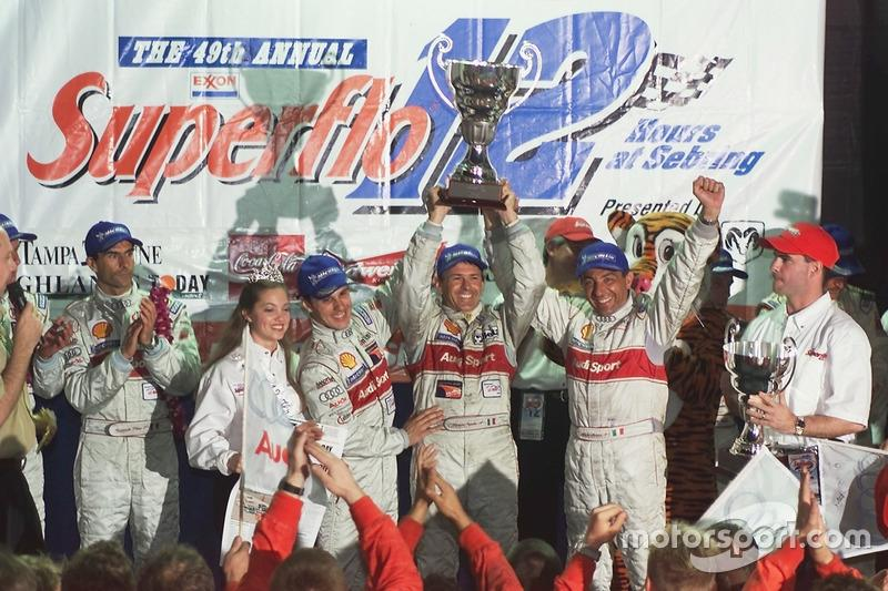 "Laurent Aiello, Capello, and Alboreto celebrate victory in the 2001 Sebring 12 Hours. Five weeks later, Michele was gone.<span class=""copyright"">Audi Communications Motorsport</span>"