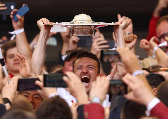 Football Soccer - VfB Stuttgart v Wurzburger Kickers - 2. Bundesliga - Mercedes-Benz Arena, Stuttgart, Germany - 21/5/17 VfB Stuttgart's Christian Gentner celebrates promotion with the trophy Reuters / Kai Pfaffenbach Livepic DFL RULES TO LIMIT THE ONLINE USAGE DURING MATCH TIME TO 15 PICTURES PER GAME. IMAGE SEQUENCES TO SIMULATE VIDEO IS NOT ALLOWED AT ANY TIME. FOR FURTHER QUERIES PLEASE CONTACT DFL DIRECTLY AT + 49 69 650050.
