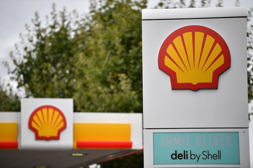 Logos are pictured at a Shell petrol station in Etlham, southeast London on September 30, 2020. - Royal Dutch Shell will axe up to 9,000 jobs or more than 10 percent of its global workforce, the energy giant said Wednesday as the coronavirus pandemic slams oil demand and prices. The Anglo-Dutch group will cut between 7,000 and 9,000 positions by the end of 2022, including 1,500 staff who have agreed to take voluntary redundancy this year, it said in a statement. (Photo by Ben STANSALL / AFP) (Photo by BEN STANSALL/AFP via Getty Images)